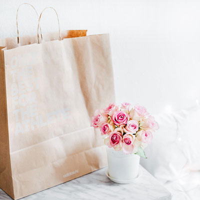 A brown bag and flowers.